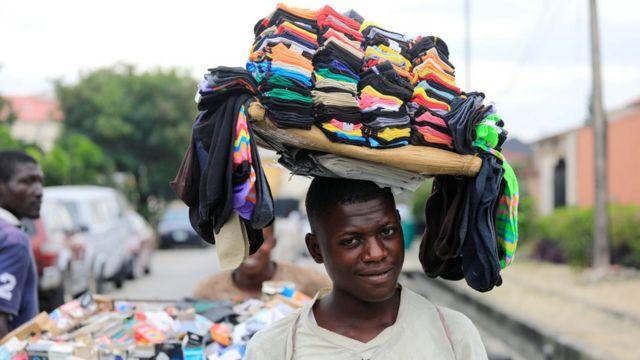 A man sells socks along a street in Lekki, Lagos, Nigeria September 12, 2017
