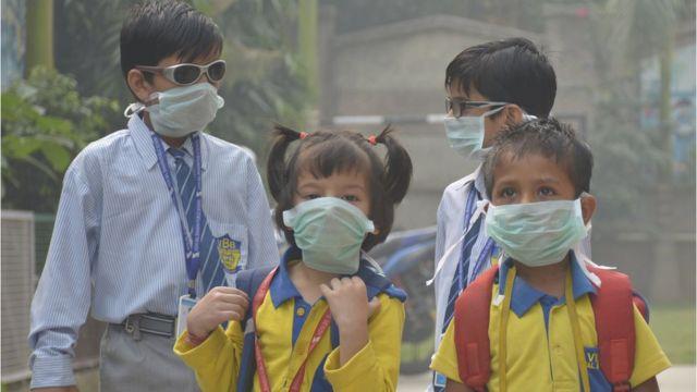 hildren wear mask at Vasundhara, Sector 11on October 31, 2019 in Ghaziabad, India
