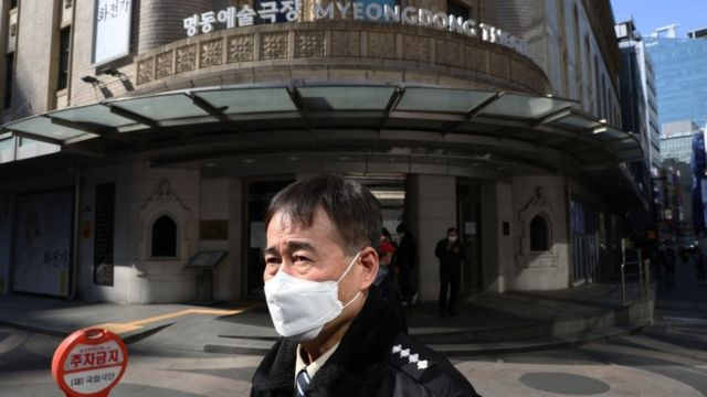 A South Korean woman wears a mask to protect herself from the coronavirus in Seoul