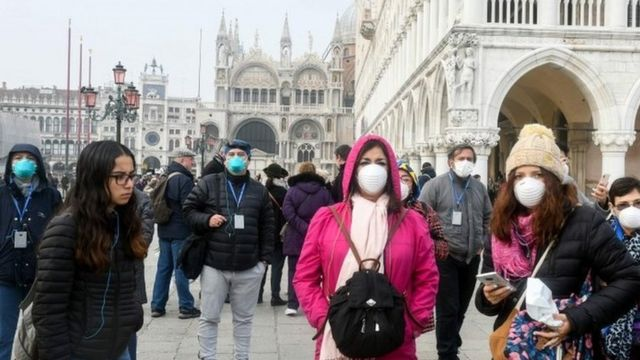 People wear masks in Venice, Italy. Photo: 25 February 2020