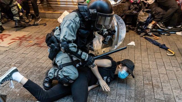 Riot police arresting a Hong Kong protestor