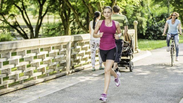 A jogger running through a park