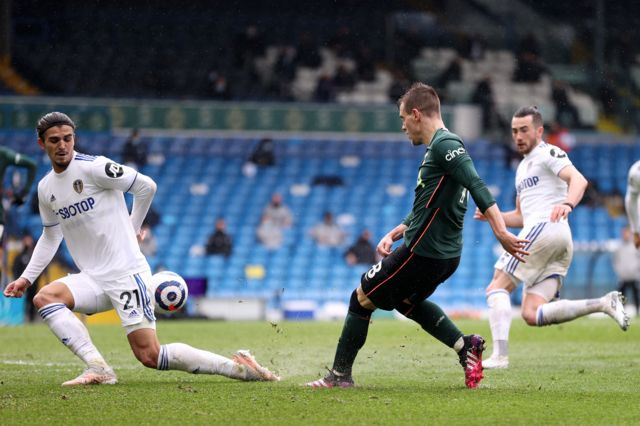 Leeds defender Pascal Struijk blocks a pass from Tottenham's Giovani lo Celso