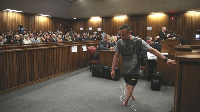 Oscar Pistorius walks on his stumps in the High Court in Pretoria, South Africa, 15 June 2016.