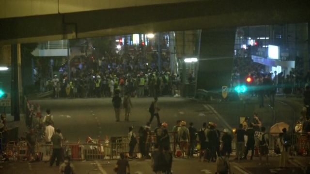 protesters on the street after nightfall June 12