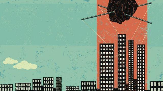 Ilustração mostra mão manipulando parte de uma cidade, representada por prédios, como marionete