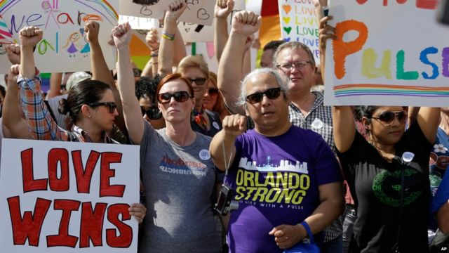 People holding banners supporting the LGBT community