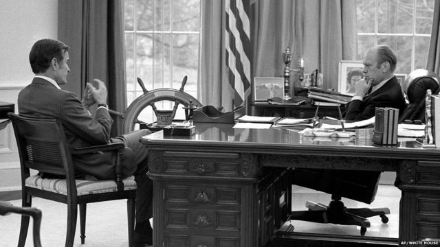 This White House file photograph shows President Ford, right, as he meets with then Central Intelligence Agency Director-designate George HW Bush in the Oval Office, December 17, 1975.