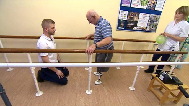 Ken Poole learning to walk at Nottingham City Hospital's mobility centre