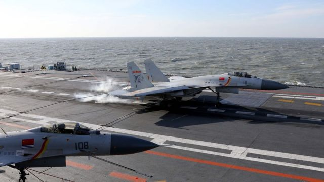 Chinese J-15 fighter jet landing on the deck of the Liaoning aircraft carrier during military drills in the Bohai Sea, off China's northeast coast.