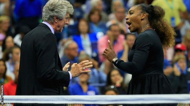 Serena Williams speaks with referee Brian Earley before continuing with her match against Naomi Osaka