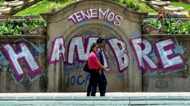 """Graffiti in Caracas reads: """"We're hungry"""""""