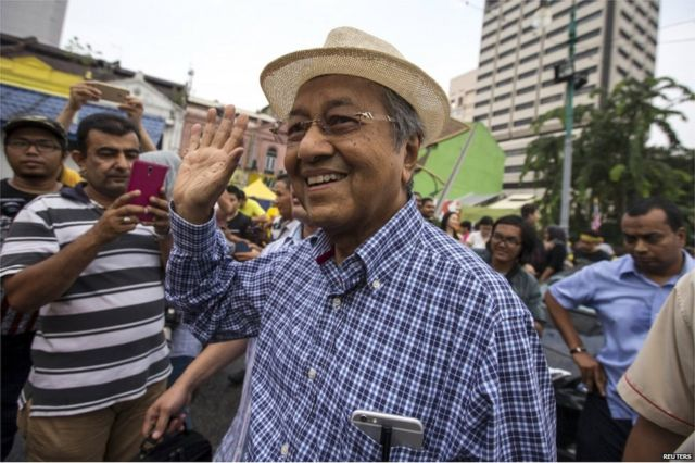 Malaysia police to question former PM Mahathir over rally