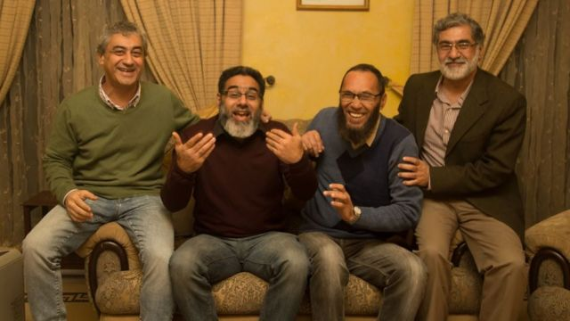 Naeem Rashid laughing with three brothers