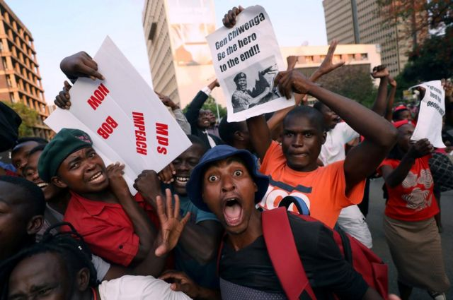 Zimbabweans celebrate after President Robert Mugabe resigns in Harare, Zimbabwe, 21 November 2017.