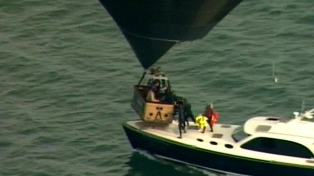 People in hot air balloon basket given life jackets from boat