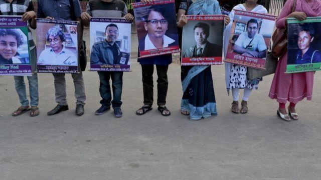 Bangladeshi activists hold portraits from left of, Niloy Nill, Humayun Azad, Avijit Roy, Arefin Dipon, Nazimuddin Samad, Rajib Haydar, Wasiqur Babu who are among those killed in the last few years.