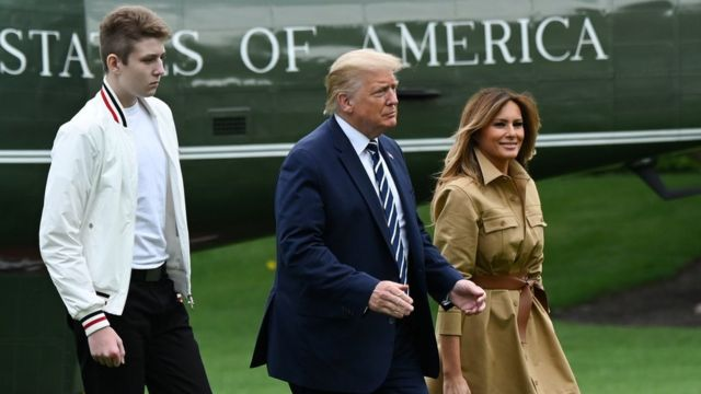 US President Donald Trump, First Lady Melania and their son Barron walk to the White House from Marine One in Washington, 16 August, 2020.