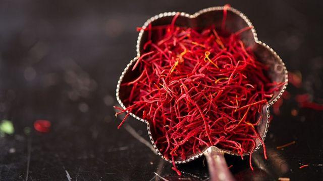 Saffron spice threads in vintage silver bowl