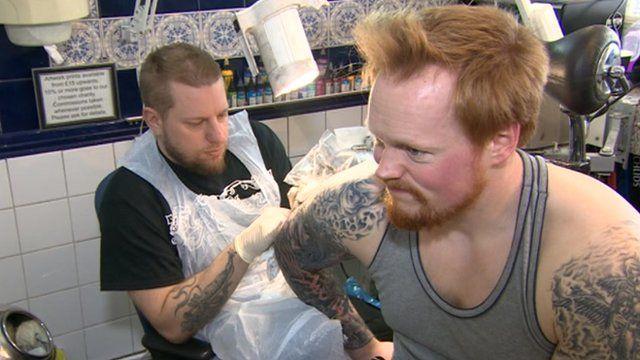 Man being tattooed