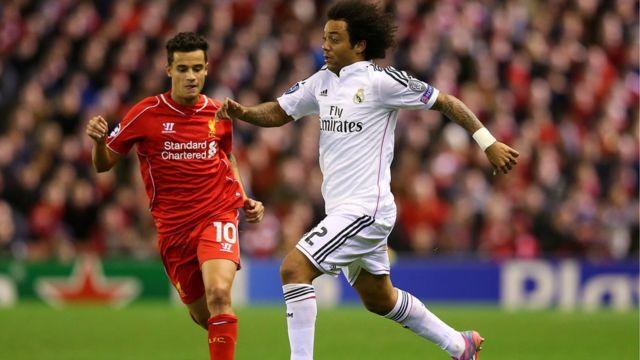 Marcelo na Real Madrid da Philippe Coutinho na Liverpool suna bin kwallo a kararwar da Real Madrid ta lallasa Liverpool da 3-0