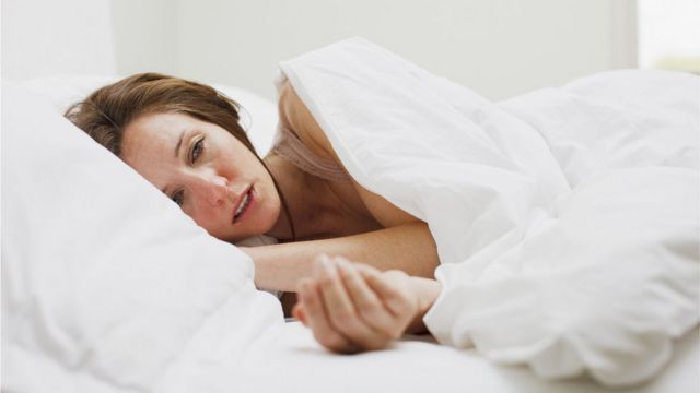 Woman with fatigue in bed