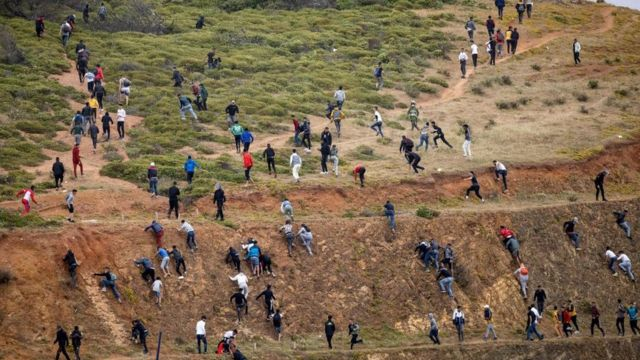 On the Moroccan side, the migrants try to avoid the local police to reach the border with Spain.