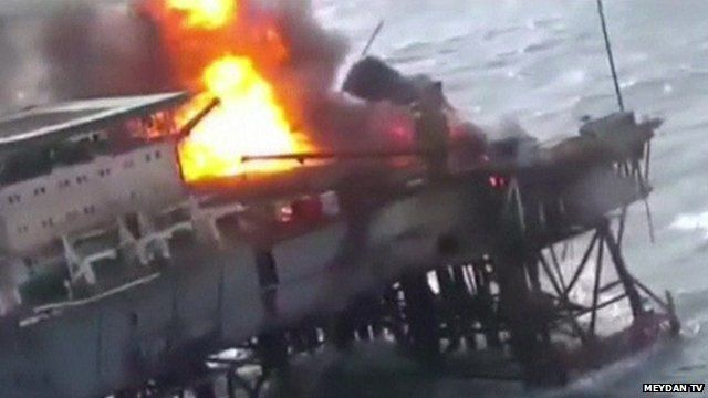 Helicopter-shot image of fire on oil rig