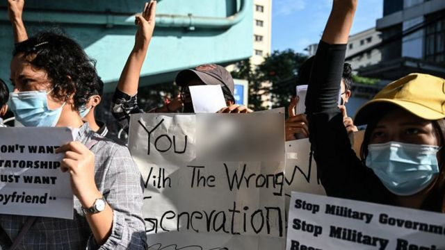 """""""You [expletive] with the wrong generation"""" read one sign, suggesting that these young protesters won't accept the coup"""
