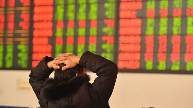 An investor observes the stock market at an exchange hall on January 13, 2016 in Fuyang, Anhui Province of China.