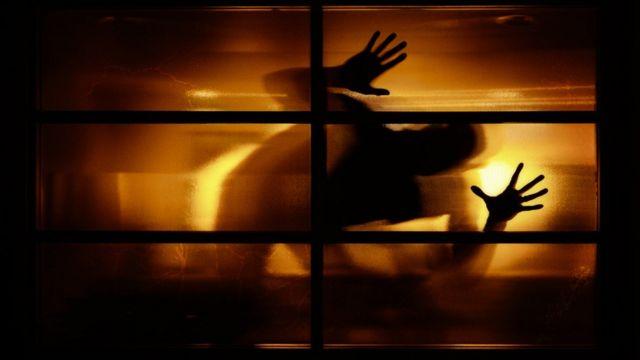shadow of man at window