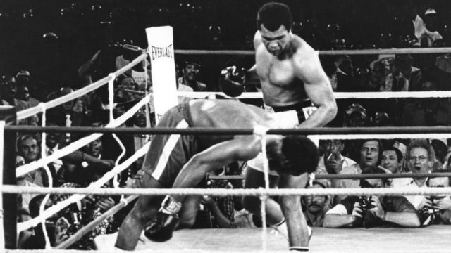 Muhammad Ali watches as defending world champion George Foreman goes down to the canvas in the eighth round of their WBA/WBC championship match in Kinshasa, Zaire - 30 October 1974
