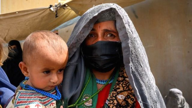 Image shows an Afghan woman in Helmand province earlier this year