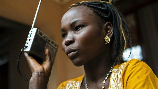 An athlete in South Sudan listening to the radio, March 2016