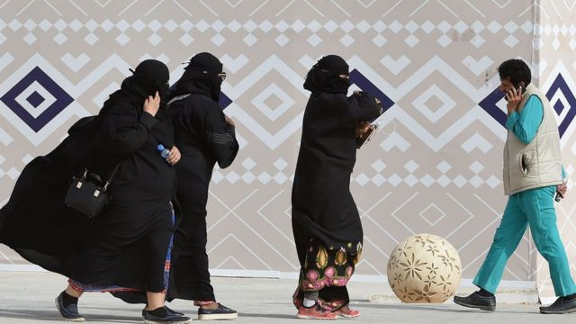 Saudi women wearing the abaya at a camel festival