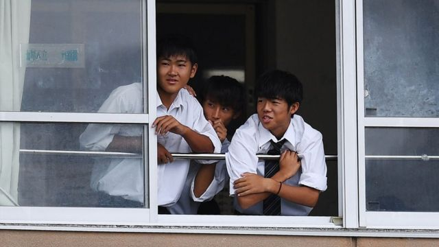 Students watch rugby practice from their classroom in Ichihara