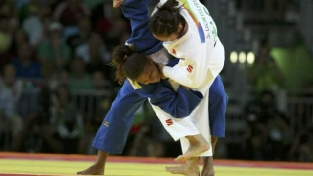 Judoka Silva in action with her Olympic opponent