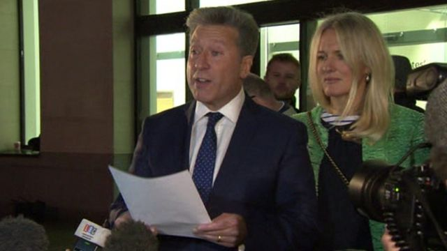 Neil Fox, with his wife, giving a statement outside Westminster Magistrates' Court