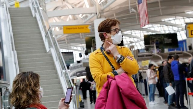 Passengers at New York's JFK airport. Photo: 13 March 2020