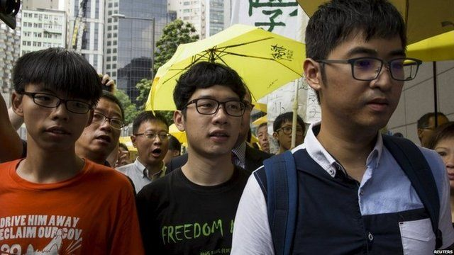 Joshua Wong, Nathan Law and Alex Chow (L-R) arrive at the police station in Hong Kong (27 Aug 2015)