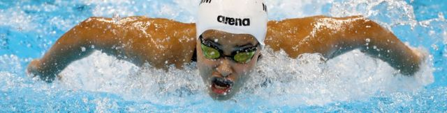 Yusra Mardini in the water swimming butterfly
