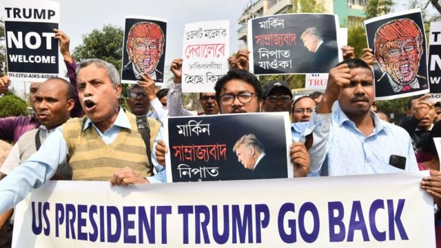 Indian protesters carry placard with message wey dey ask Donald Trump to comot India