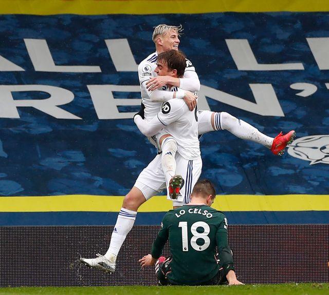 Patrick Bamford and Ezgjan Alioski celebrate a goal against Tottenham