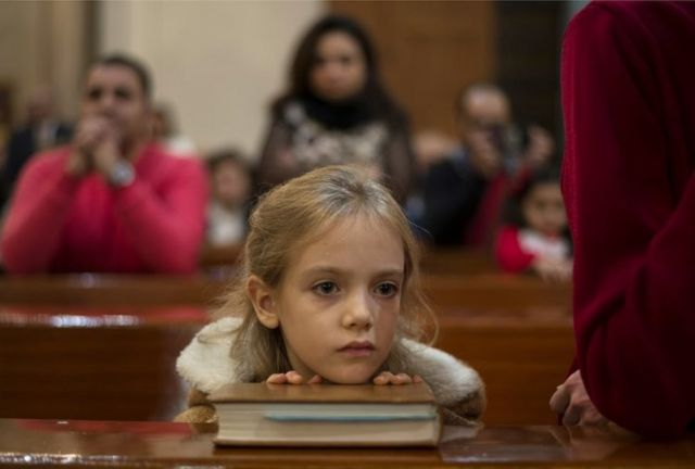 A girl attends a Christmas Eve mass in Cairo, Egypt