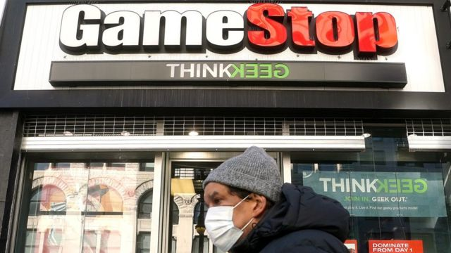 A person walks past a GameStop in the Manhattan borough of New York City, New York, U.S., January 29, 2021.