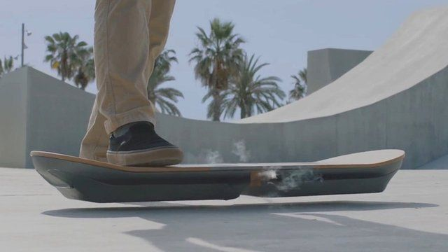 A man stepping on to a hoverboard