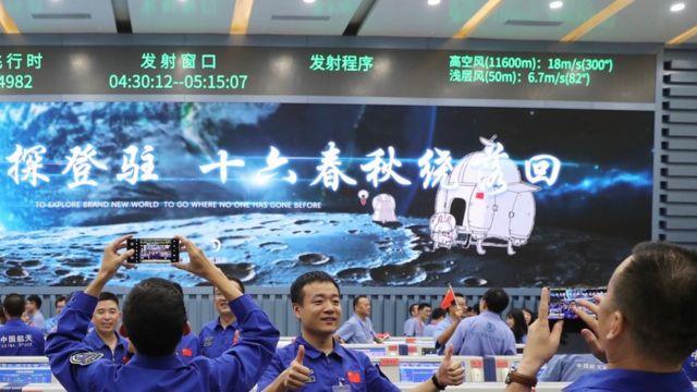 equipe chinesa comemora