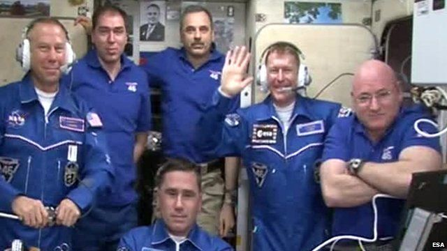Tim Peake (second from R) and ISS crewmates
