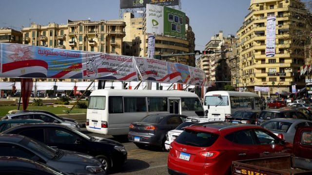 "Banners in Tahrir Square, Cairo, tell Egyptians to ""do what is right"" and that ""participation is a responsibility"" (8 April 2019)"