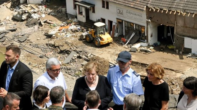 Mrs Merkel (centre) and Rhineland Palatinate premier Malu Dreyer (second right) talk to residents in Schuld